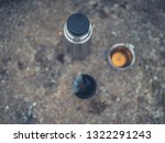 a flask and two cups of tea on... | Shutterstock . vector #1322291243