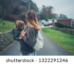 a young mother is standing in... | Shutterstock . vector #1322291246