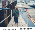 a little toddler is walking... | Shutterstock . vector #1322292770