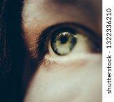 green human eye closeup photo | Shutterstock . vector #1322336210