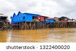 floating village on tonle sap... | Shutterstock . vector #1322400020