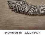 pile of nails shot on a wooden background - stock photo