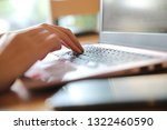 woman hand working at coffee... | Shutterstock . vector #1322460590