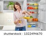 young  slender woman standing... | Shutterstock . vector #1322494670