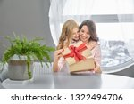 daughter congratulating  giving ... | Shutterstock . vector #1322494706