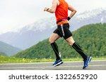 man runner in compression socks ... | Shutterstock . vector #1322652920
