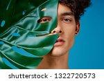 cute elegant man holding a palm ...   Shutterstock . vector #1322720573