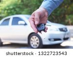 the car owner is standing the... | Shutterstock . vector #1322723543