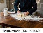 female chef kneading dough in... | Shutterstock . vector #1322771060