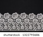 white lace on black background | Shutterstock . vector #1322793686
