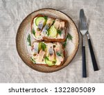 Stock photo herring smorrebrod traditional danish sandwiches black rye bread with herring on gray napkin 1322805089