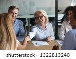 smiling mature businesswoman... | Shutterstock . vector #1322813240