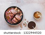 Stock photo masala chai kulfi served with biscuit crumbles chocolate syrup and some dry rose petals on top 1322944520