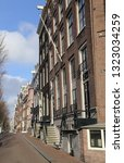 street with historical houses... | Shutterstock . vector #1323034259