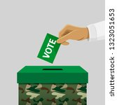 election boxes  hand dropping a ... | Shutterstock .eps vector #1323051653