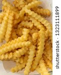 portion of chips  crinkle cut... | Shutterstock . vector #1323111899