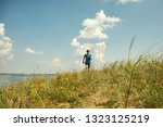 athletic young jogging man... | Shutterstock . vector #1323125219