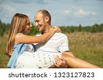 young happy couple in love.... | Shutterstock . vector #1323127823