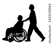 silhouettes disabled in a wheel ... | Shutterstock .eps vector #1323155063
