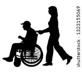 silhouettes disabled in a wheel ... | Shutterstock .eps vector #1323155069