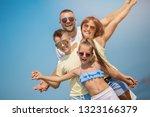 summer holidays. family having... | Shutterstock . vector #1323166379