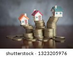 mini house on stack of coins ... | Shutterstock . vector #1323205976