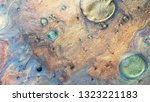 colorful sparkling paints mix... | Shutterstock . vector #1323221183