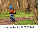 young boy riding his bike on... | Shutterstock . vector #132325469