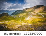 aerial view on a winding road... | Shutterstock . vector #1323347000