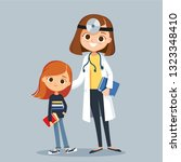 female doctor pediatrician with ... | Shutterstock .eps vector #1323348410