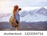 beautiful woman with backpack... | Shutterstock . vector #1323354716