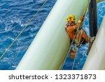 working at height. abseiler... | Shutterstock . vector #1323371873