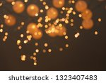 blurred view of gold lights on... | Shutterstock . vector #1323407483