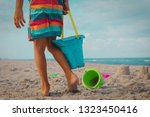 little boy play with sand on... | Shutterstock . vector #1323450416