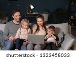 happy family watching cartoons... | Shutterstock . vector #1323458033