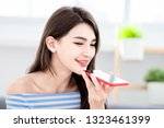 asian woman use ai vocal...   Shutterstock . vector #1323461399