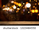 Stock photo beer barrel with beer glasses on a wooden table the dark brown background 1323484550