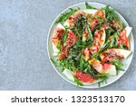 salad with arugula  melon and...   Shutterstock . vector #1323513170