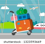 airport baggage trolley with... | Shutterstock .eps vector #1323593669