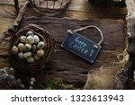 easter table setting.quail eggs ...   Shutterstock . vector #1323613943