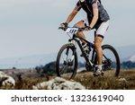 athlete cyclist riding mountain ... | Shutterstock . vector #1323619040