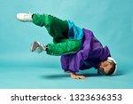 man break dance | Shutterstock . vector #1323636353