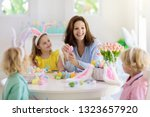 mother and kids color easter...   Shutterstock . vector #1323657920