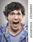 screaming young man portrait | Shutterstock . vector #132366863