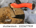 the wood chopper sticks out in...   Shutterstock . vector #1323677939