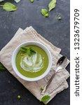 vegan soup of green peas and... | Shutterstock . vector #1323679709