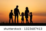 silhouettes of happy family...   Shutterstock . vector #1323687413