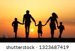 silhouettes of happy family...   Shutterstock . vector #1323687419