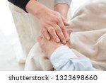 nursing care  senior  holding... | Shutterstock . vector #1323698660