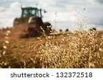 Close Up Of Crop With Tractor...